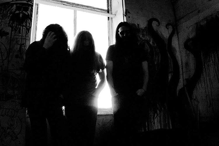 Three members of Doom/Sludge Band Nomadic Rituals